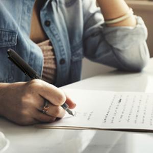 Varsity - Girl Using Varsity Fountain Pen To Write