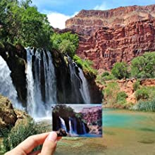zink photo paper in front of a waterfall