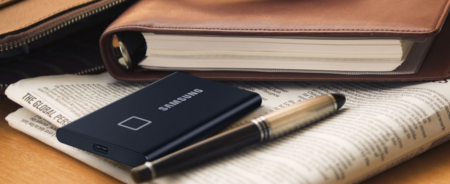 Samsung Portable SSD T7 Touch placed on a newspaper