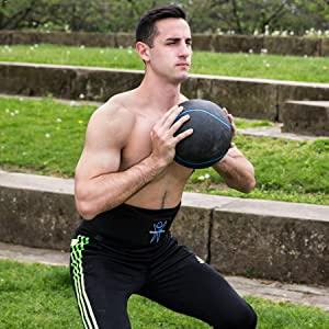Man with ComfyMed Breathable Mesh Lower Back Brace playing Ball