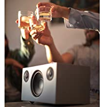 Audio Pro Addon C10 Multi-room WiFi Smart Speaker grey at a party celebration and drinks