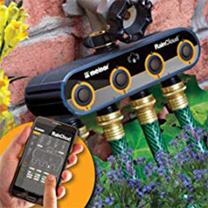 Remote controlled Melnor Automatic Watering Timer connected to four hoses