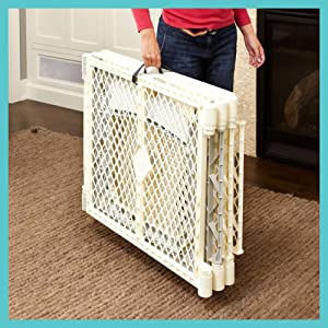 a baby gate loaded with features