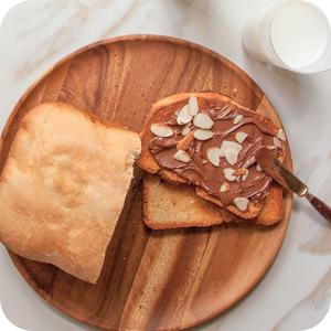 Image of toast being smothered with spread.