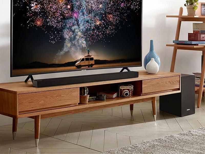 Soundbar below a Samsung QLED TV