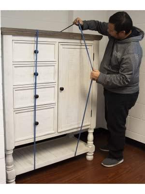 Forearm Forklift mover's rubber bands being used to keep drawers and doors of a cabinet closed