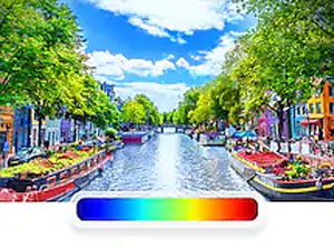 QLED TV with colorful canal scene