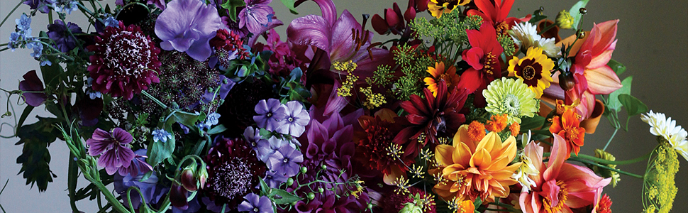 rainbow floral arrangement in purple and orange for cultivated