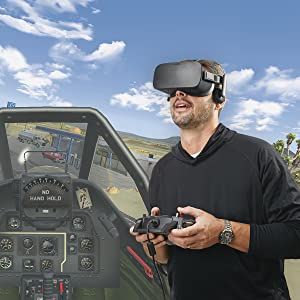 Composite image of interior of simulated cockpit with inset of guy in VR goggles using controller