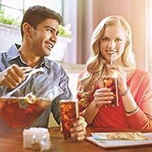 A man and a woman enjoying Lipton iced tea