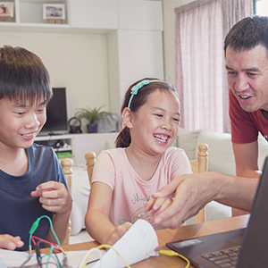 a father helping his children with activities at home