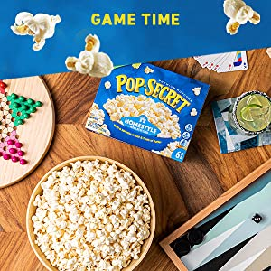 POP SECRET  popcorn bowl served on a table with board games