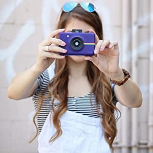 lady pointing Purple camera instant
