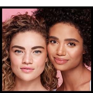 COVERGIRL models with light and medium skin tone wearing COVERGIRL Clean Fresh Skin Milk