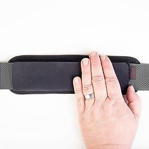 Close touch fasteners around strap.