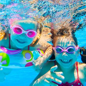 Girls playing underwater - Neutrogena Wet Skin Kids Sunscreen goes on your child's skin wet or dry