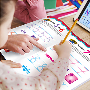 a preschool girl working on inside pages