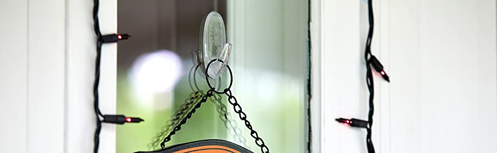 Command Window Hook on outdoor window on a house holding a sign