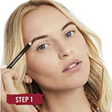 Close-up of woman's face applying Rimmel Professional Eyebrow Pencil