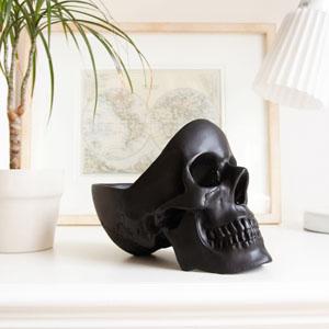 black skull tidy on sideboard