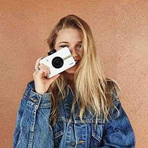teen holding white instant camera