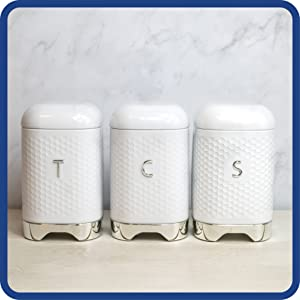 Storage canisters in a row in a modern kitchen setting