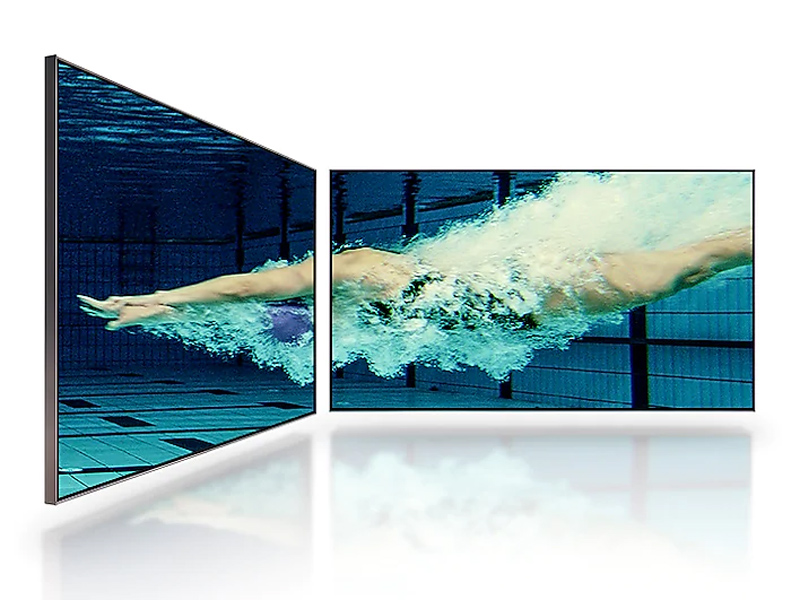 TV displaying an underwater scene of a swimmer from multiple angles