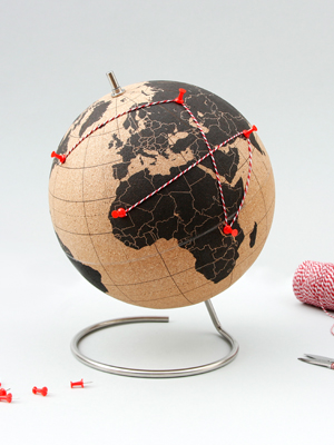 original cork globe with red push pins and string