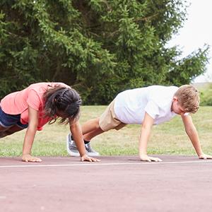 two kids doing push-ups