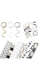 Black, white, gold and silver reversible wrapping paper with ribbon and gift tag stickers