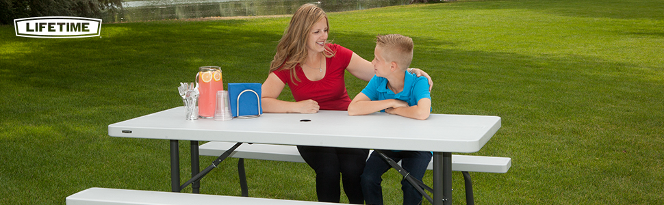 Mother and son outside sitting at a Lifetime Picnic Table.