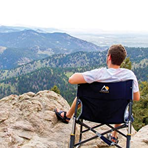 Man enjoying the view sitting on a GCI Outdoor chair