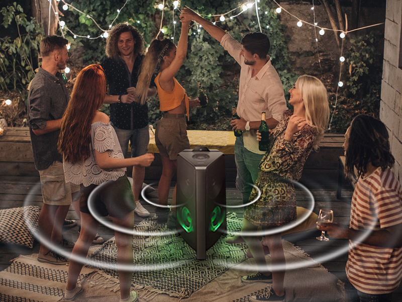 People dancing at a party with Samsung GIGA Party Soundbar