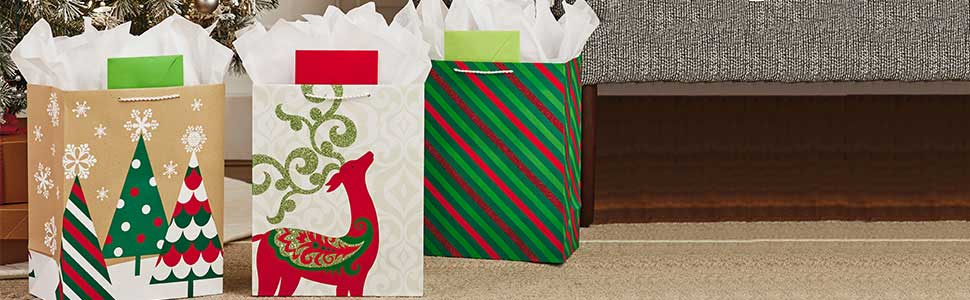 Christmas gift wrap supplies by Hallmark including gift bags with tissue paper, bows amp; sticker tags