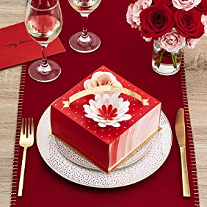 Red and gold gift box with 3D paper flowers for Valentines Day dinner with wife or girlfriend