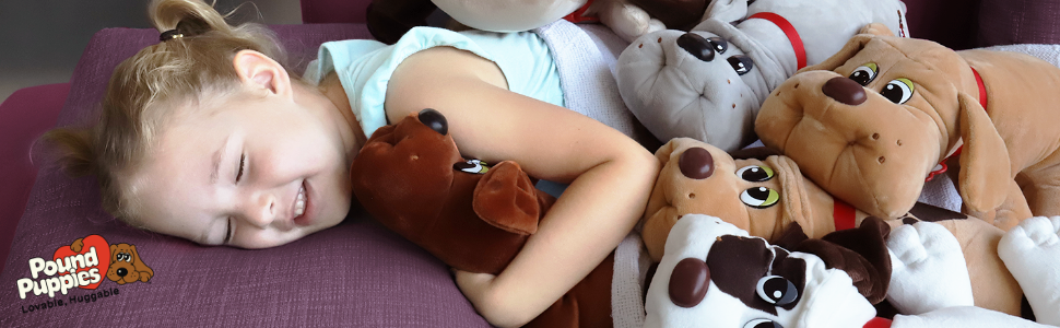 lifestyle image of girls sleeping with all the puppies