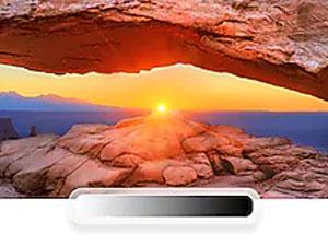 UHD TV with desert scene at sunset