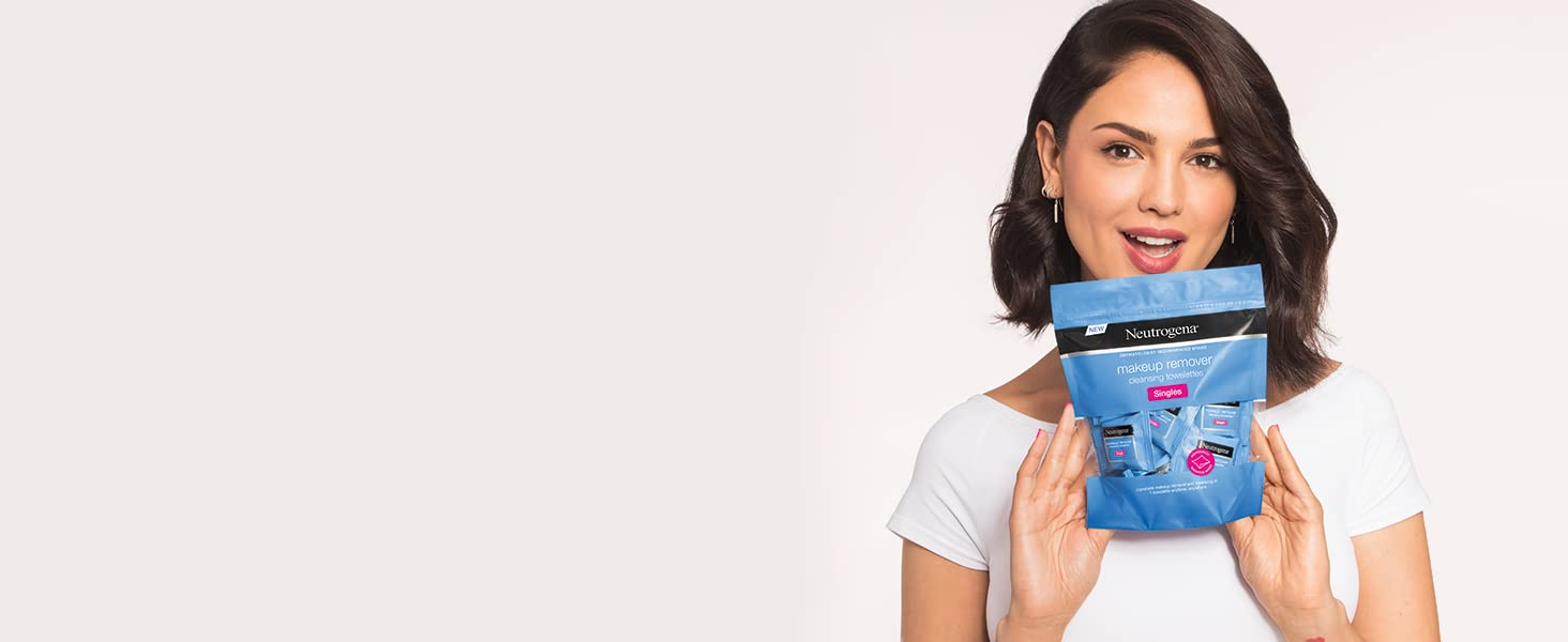 Woman holding a package of Neutrogena Makeup Remover Cleansing Towelette Singles