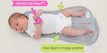 Woombie Original Baby Swaddle allows baby to sleep in recommended hands over heart sleep position