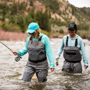 Fly fisherman and woman