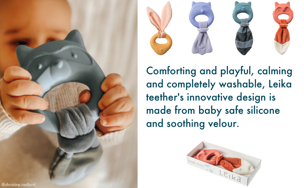 baby holding teething toy