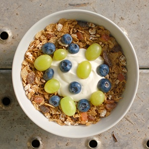 bowl of kellogg's just right cereal with blueberries, grapes and yoghurt