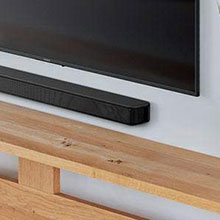 Wall mounted HT-S100F soundbar paired with a wall mounted TV