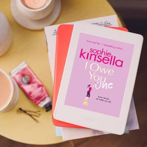 I Owe You One kindle ebook lifestyle image with handcream and candle on bedside table