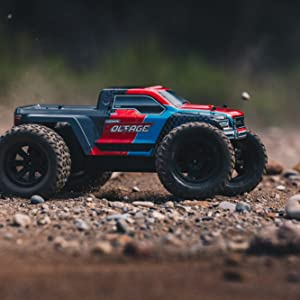 Side view of RC Monster Truck in action on gravel and dirt path