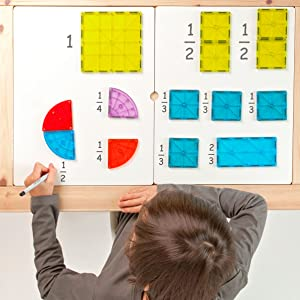 young child practicing fractions with Magna-Tiles magnetic building tiles on a dry erase surface