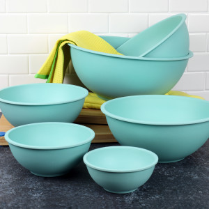 a family of light blue kitchen bowls on a countertop