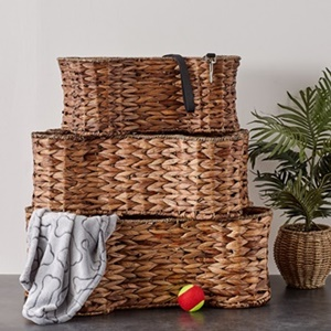 Hyacinth Pet Bone Shape Baskets from Bone Dry in 3 different sizes stacked on top of each other.