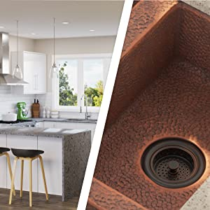 Sinks are crafted in one piece from 99%-pure mined copper, and feature a hand-hammered texture.