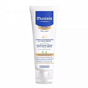 Bottle of gentle daily face cream, absorbs easily, lotion helps protect and hydrate dry skin